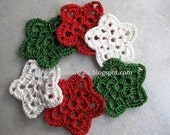 Christmas decoration,green, white, and red crochet stars, appliques, tags