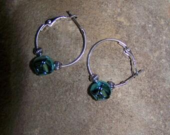 Silver hooped green bell earrings