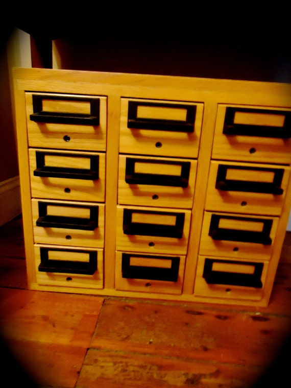 vintage library card catalog file cabinet with industrial