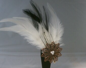 white and black feather hair clip