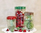 Vintage canning jar canister set painted in red, brown, and green