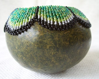 Small marbled look green gourd bowl with beaded swag rim pattern.  Item 1170.