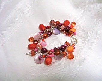 Pinks and oranges charm bracelet