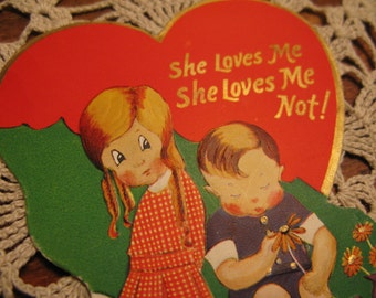 She Loves Me, She Loves Me Not 1940s Valentine card, gold paint, signed in pencil.