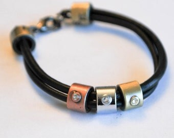 Black leather with 3 colors metal with rhinestones Lobster Clasp bracelet