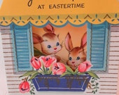 Vintage 1950s Cute Bunnies in a window with yellow awning with tulips Easter  Greeting  Card