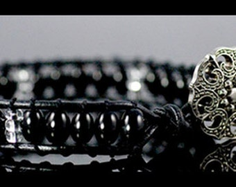 Black Leather Beaded Bracelet with Metal Button Closure