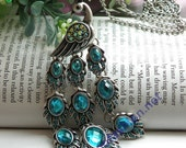 Pretty retro silver blue crystals expanding feathers peacock necklace pendant vintage style