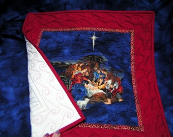 Quilted nativity embroidered stars and red scrolls border