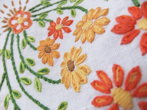 Vintage embroidered tablecloth with orange, peach and apricot flowers