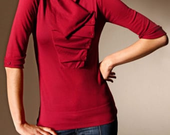A beautiful red blouse with an asymmetrical collar.