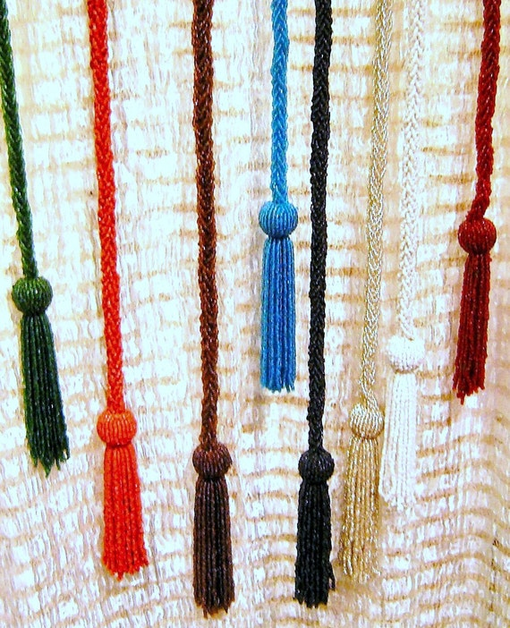 vintage glass beaded belts as curtain tie backs pair