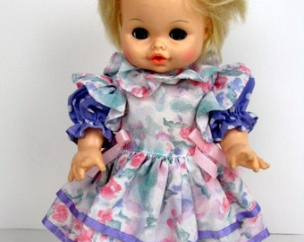 Vintage 1972 Horsman Baby Doll with Purple dress