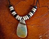 Polished Rainbow Stone Pendant with Dyed Wood Beads