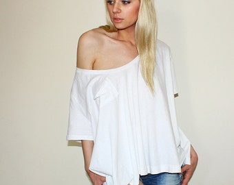 Oversized flowy top with bateau neckline and chest pocket