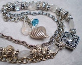 Bracelet crystals moonstone multi strand antiqued silver charms One Of A Kind ocean blue Bird in Hand