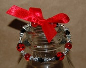 Ladybug Beaded Bracelet with Red Bow Party Favor (costume jewelry)
