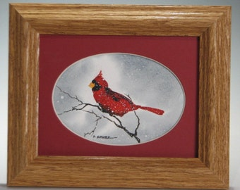 Handmade Watercolor of a Red Cardinal perched on a branch (Framed) 5x6