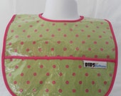 Chartreuse bib with bright pinks dots and pocket