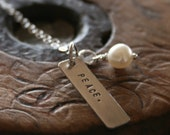Single 1 inch sterling silver  tag and pearl