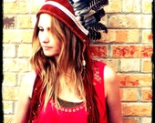 Handmade feather headdress adorned with suede leather, fringe and beads