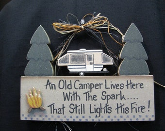 An Old Camper Lives Here With The Spark -----