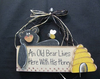 An Old Bear Lives Here With His Honey.