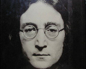 The Lives of John Lennon Book by Albert Goldman and Beatles Postcard