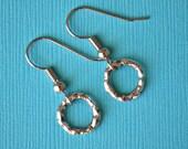 Silver Hammered Hoops . Earrings