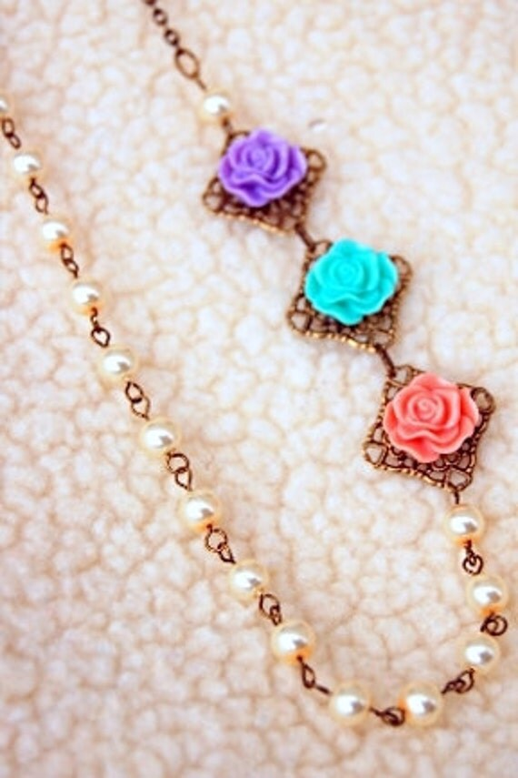 Asymmetrical filigree flower cabochon pearl necklace. Pink, teal, and lilac