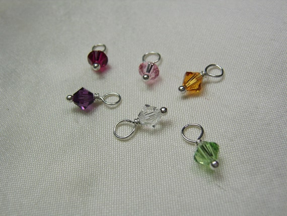Add a small Swarovski birthstone crystal dangle to personalized initial necklace or other MesmericJewelry item