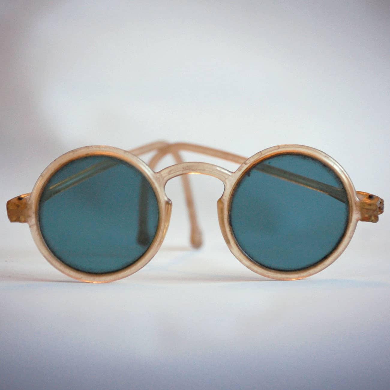 Plastic Glasses Frame Bent : Round Antique Sunglasses with Translucent Plastic Frames