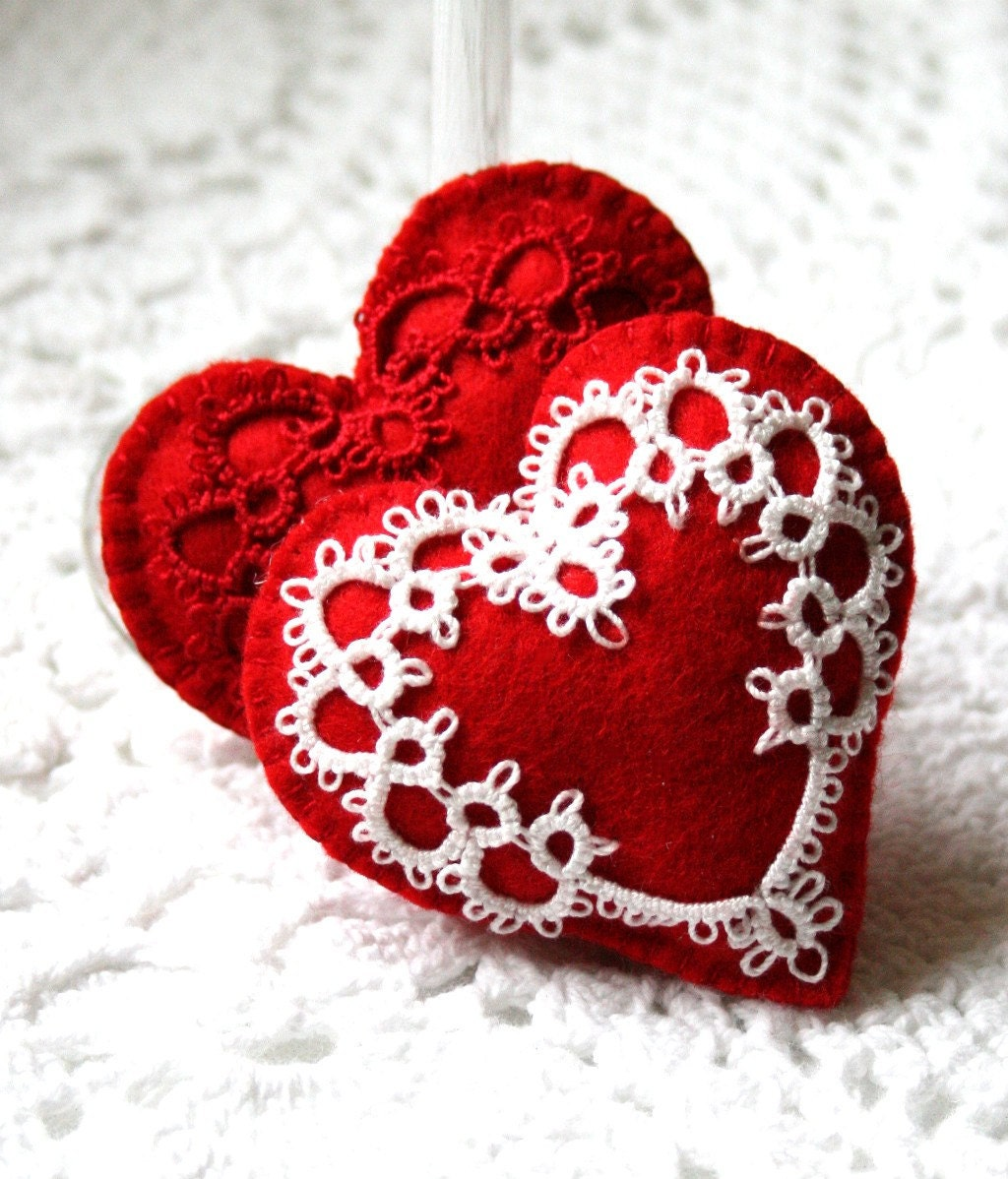 two red felt heart sachets with tatted hearts