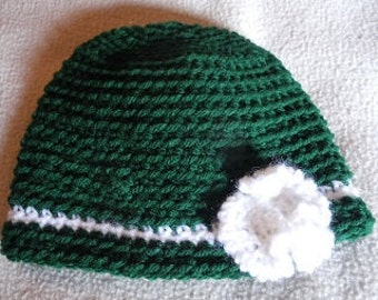 Adorable green infant hat with white flower