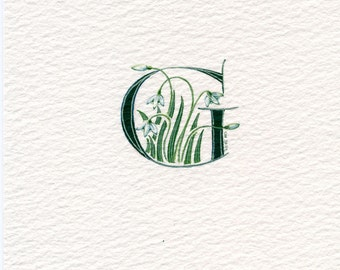 Initial letter 'G' in dark green with snowdrops custom initials gifts handmade initials.