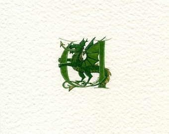 Initial letter 'U' in green with a green and gold dragon fantasy mythical animal gift.