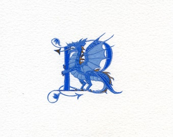 Initial letter 'R' in blue with a blue and gold dragon Fantasy animal mythical storybook letter