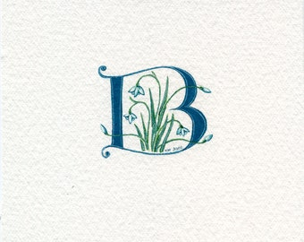 Initial letter in dark green with snowdrops custom initial gift