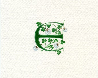 Initial letter 'E' in green with white clover custom initials