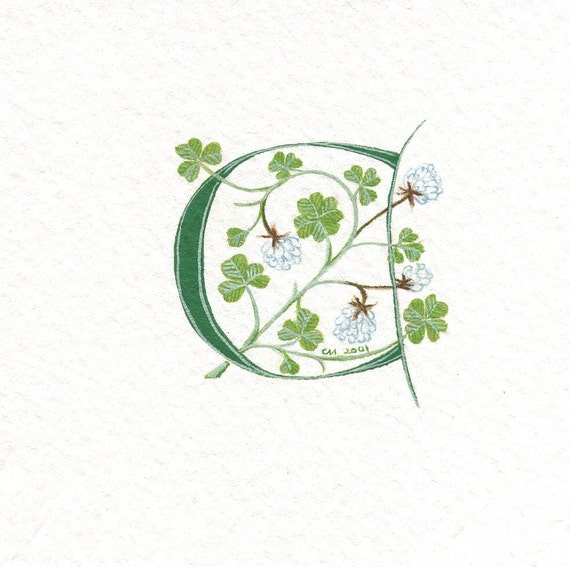 Initial letter 'C' handpainted in green with lucky white clover.