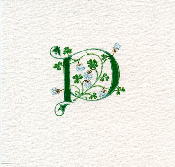 Initial letter 'P' handpainted in green with lucky white clover.