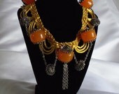 Vintage beaded necklace, orange glass, silver detailed charms and chain on vintage gold ribbon