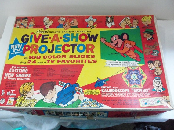 Vintage cartoon projector, Kenners give a show projector, baby boomer cartoons, every piece included, excelent condition