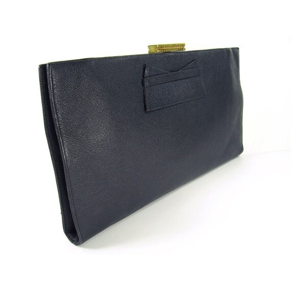 MIU MIU Navy leather clutch with gold detailing. I purchased this bag on trueiupnbp.gq for approx $ The bag is in excellent condition. The clutch is 28cm long and 17cm in height. Seller assumes all responsibility for this listing. Postage and handling.