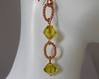 Yellow green copper dangle earrings.