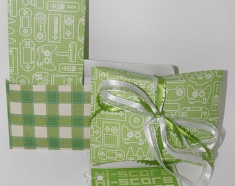 Money card holder and gift box combo gift wrap kit with video game consoles graphics.