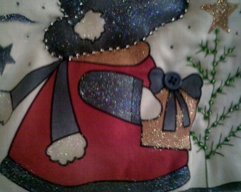 Puffy mini-quilt wall hanging for the holidays.  Sun Bonnet Sue and her snowman ready to hang on your wall.