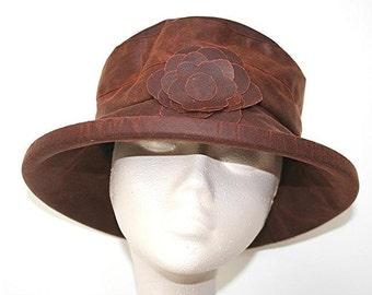 Waxed cotton rain hat in Copper