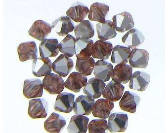 Swarovski 5301 4mm Light Peach AB  Xilion Bicone Beads Wholesale price Bulk Quantity 1 Gross (2653) - Lowest CLEARANCE Price