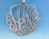 sterling silver monogram . 2 initials. 1.1/4''  size. with a chain